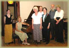 Master class participants Amanda Horn, Barbara Williams, Tamara Green, Janice Gallant, Richard VanVliet, and Elizabeth Greenhoe, with Elaine Greenfield at the piano, following a recent recital  at the Frederick Collection of historic pianos, Ashburnham, Massachusetts